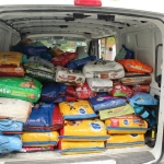 Van loaded with 2,000 pound of pet food and supplies.